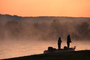 Father and son fishing at sunrise at Cane Creek Kentucky Lake Boat Slips for Rent
